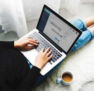 photography of person using laptop